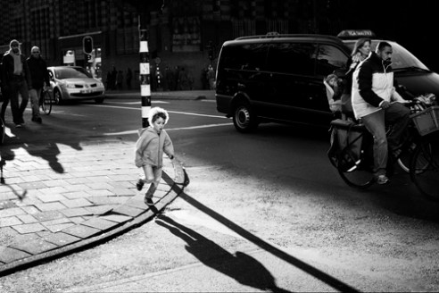 """Boy crossing a road"" Herengracht, Amsterdam"