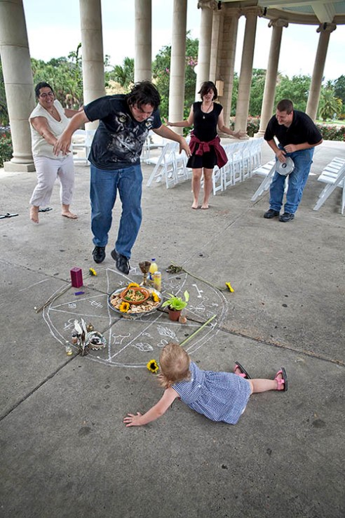 Pagen Summer Solstice 1480 NEW ORLEANS, LA. Pagans dance over the pentagram with symbolic offerings of the season as a drum beats. It is all part of a ritual to honor the Summer Solstice.