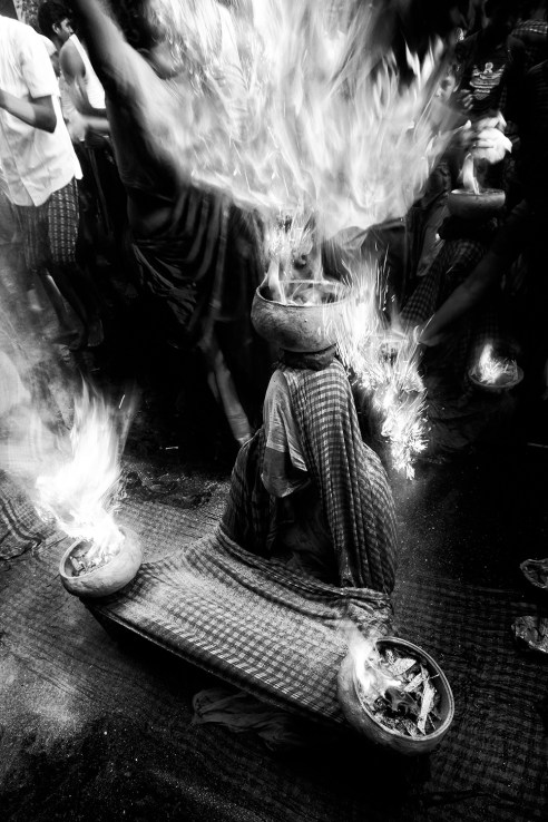 Woman are told, the well-being of her family depends on her religious practice and dedications. Over it is fascinating to see that how these believes have actually are being hold true by the women who take part in dangerous rituals like sitting with burning fire on her head and laps which is intended to bring well being to her family.