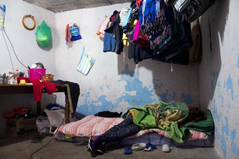 It's common to find an extremely poor neighborhood next to a luxurious one in Mexico City. This is the case of Santa Fe, where Maria lives inside a room with her 3 children, and a baby on its way.