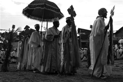 The celebrations start with a procession of priests holding their churches crosses