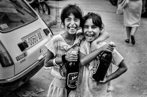 "Xibeca Two Gypsy girls training two bottles of a very popular Beer ""Xibeca"" Vilanova i la Geltrú, 1990"