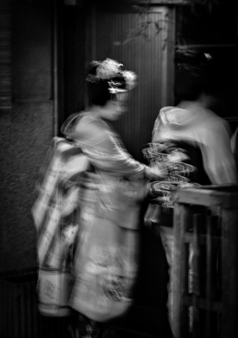 A geisha enters a restaurant. Gion District, Kyoto
