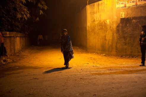 ' Night streets of Gazipur' A female garment worker walks home alone. Dhaka, Bangladesh
