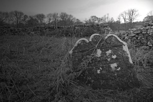 'Eroded by time'. The burial ground of the clan Diarmid, at Cladh Dabbhi, Perthshire, Scotland. Before the Highland Clearances, the clan Diarmid occupied this area. Now there are few left bearing the name.