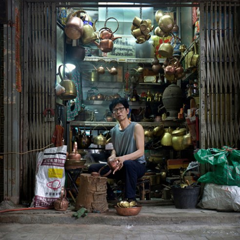 Shaowei Su, a copper craftsman. He began making copper at 19. He said he loved copper and were always making coppers for a whole day. His work made him feel happy.