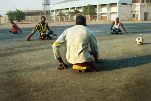 Members of KPVTA practicing para-soccer. They can reach high speed by sitting on small wooden skateboards and pushing themselves by hands protected by flip-flops. Kano, Nigeria
