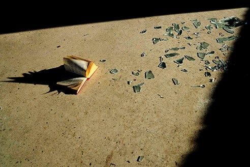 Old book on the floor of abandoned building, Athens, Greece.