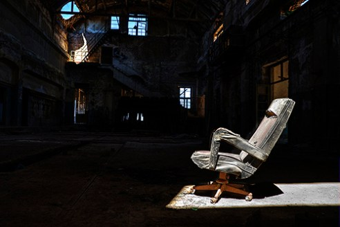 Chair inside abandoned factory, Athens, Greece.