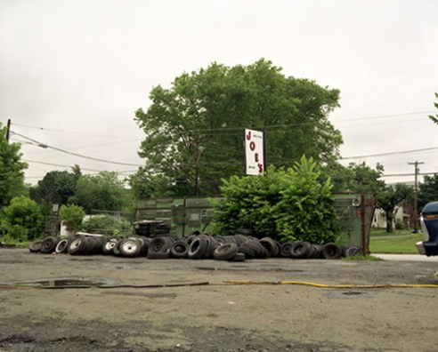 Joe's sign with tires, 2003