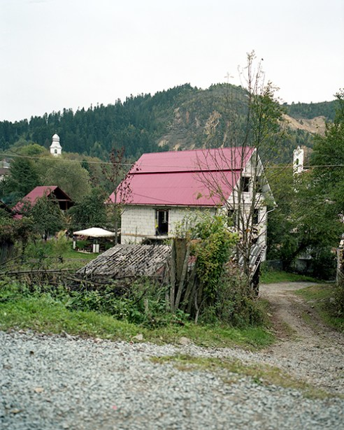 Village road and a house in Rosia Montana