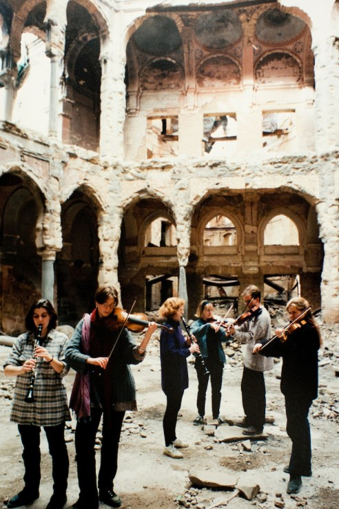 Music Therapy students play in the gutted National Library in Sarajevo..Warchild projects in Mostar and Sarajevo, in Bosnian Wars, 1994-1995.