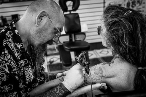 """Issy"" was busy all week making magic with ink on skin. He is one of the most sought after tatto artists who travels to Sturgis each year."