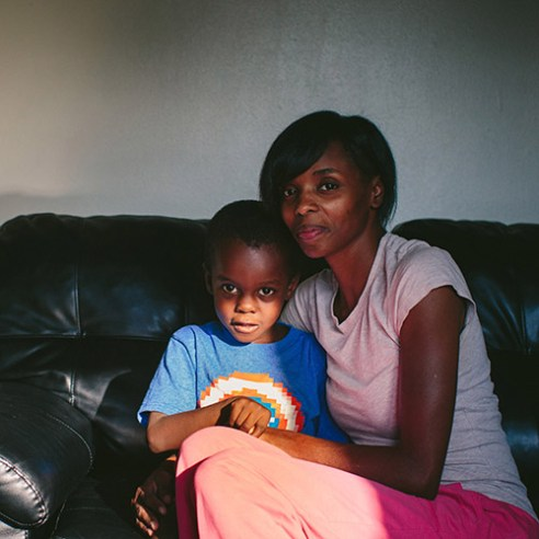 """East Chicago, Indiana Stephanie King embraces her youngest son, Josiah King, 3, whose blood lead levels test results were above the CDCís 5 mg/d threshold for action. Two and a half years ago, King left Chicago's South Side to find a safer environment for her four sons and one daughter. ìIf Iíd have known the dirt had lead, he wouldnít have been out there playing in it,"""" King said. 