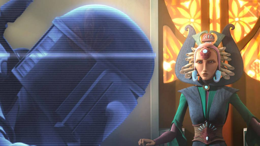 Duchess Satine watches a holovid of a Death Watch attack