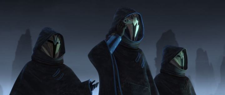 Three female Mandalorians stand on a roof watching the action from above