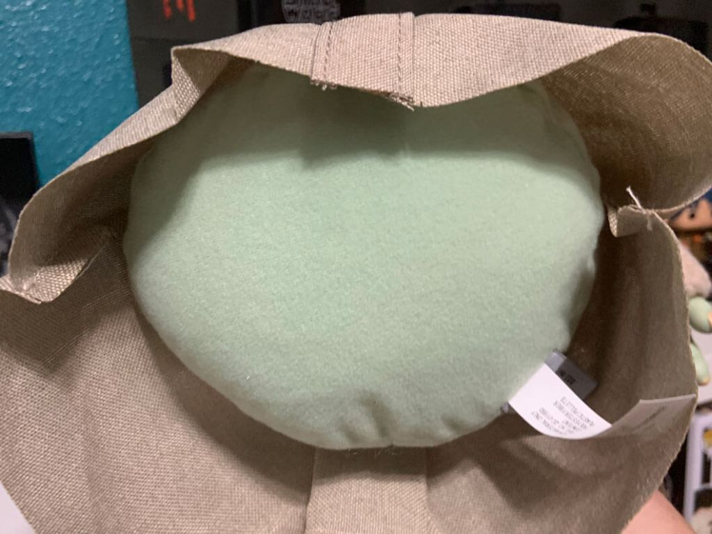 View of the bottom of The Child plush