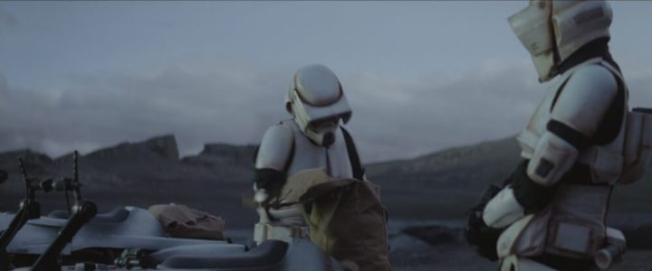 A scout trooper punches Baby Yoda after being bitten during The Mandalorian Season 1 Episode 8