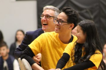Cober and students watch video at farewell assembly