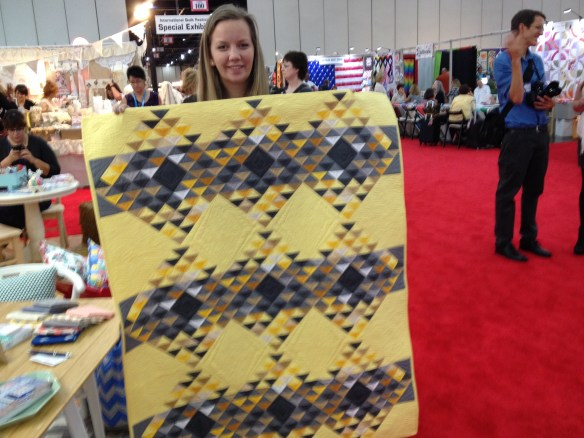Angela Walters with her new line. A real departure for her. This quilt was made with 3 half-yard panels--2 seams. The binding is made with leftovers from the panel.