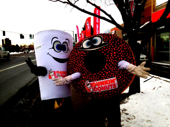Cuppy and Sprinkles dancing on the streets of Edgewater during the benefit .