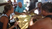 Playing dominoes on a street in Santiago de Cuba. Photo by Thelma Bowles.