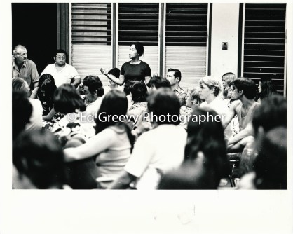 Left George Santos and Ko Hayashi listen to speaker Paige Barber at Ethnic Studies meeting 1972_