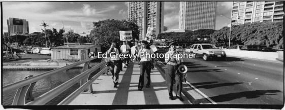 Union leader Claire Shimabukuro leards anti war march-demo to Waikiki. 9123-7-31 2005