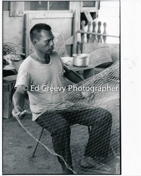 Sand Islan fisherman tending to his nets 4090-3-16 11-10-79