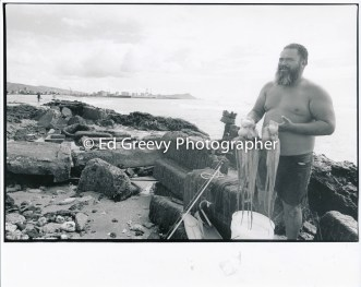 Sand Island fisherman with squid 4090-1-25A 11-10-79