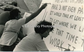 Sand Island residents prepare signs for eviction protest 4093-10-12 11-25-79