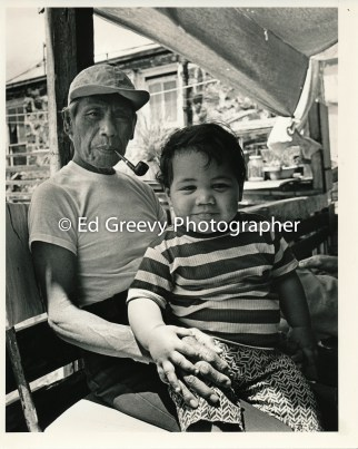 Chinatown boy and grandfather at home in Chinatown. _
