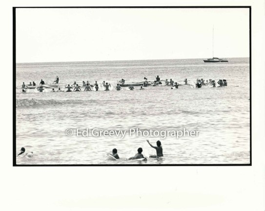 Surfers gather in the water at Queens break on %22Clean Water Day to raise clean water issues. 8028-6-28 _