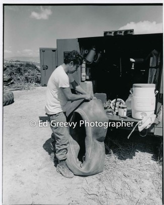 %22Junior%22 the heavy equipment operator repairs a tractor tire on Mokauea Island. 4050-8-8 4-8-79