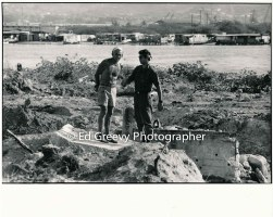 John Kelly, left, discusses Mokauea fishpond excavation with dozer operator. 4089-4-27A 10-6-79