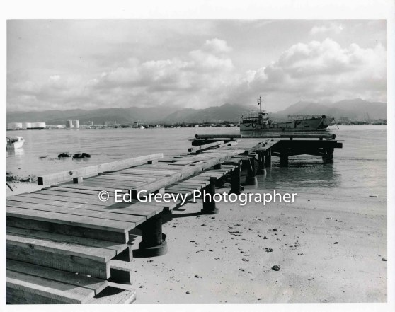 Landing dock on Mokauea Island, Army Corps of Engineers landing craft anchored in the back ground. 4089-7-4 10-6-79_