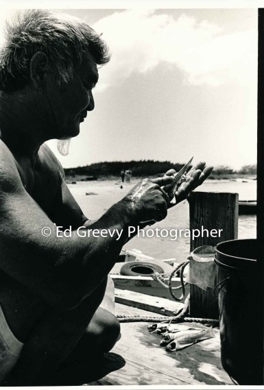 Mokauea Island fisherman cleans his catch. 2914-6-6A 8-26-75