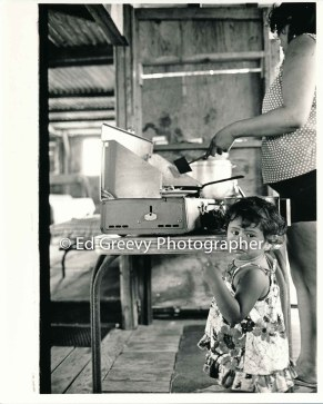 Mokauea Island mother prepares lunch on the island. 2914-7-17A 8-26-75