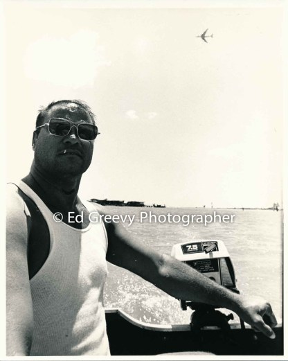Mokauea Island resident, Cobb-Adams, mptors to the island. 2914-2-19 8-26-75