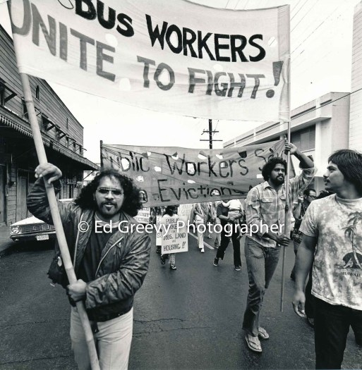 ernie-foster-9at-right-holding-banner-marches-with-stop-all-evictions-protest-marchers-through-downtown-honolulu-2950-11-12-2-14-76