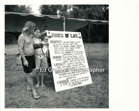 houseless-family-at-mokuleia-beach-park-with-their-sign-8-23-97