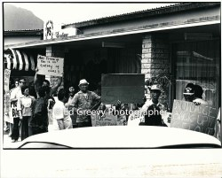 waiahole-waikane-resident-mr-guillermo-left-center-marches-in-eviction-protest-at-developer-joe-pao%ca%bbs-office-2965-1-7a-4-7-76