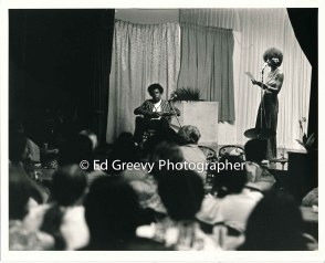 Kathryn Takara introduces poet Frank Marshall Davis at Harambe celebration. 2786 12-7-74