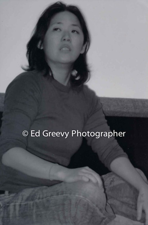 Women' Rights actvist, Kathy Xian, at slam poetry reading at Art at Marks Garage. C1980;s