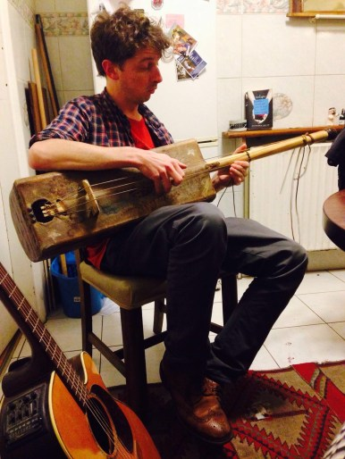Practicing the Guembri (a Moroccan instrument related to the banjo)