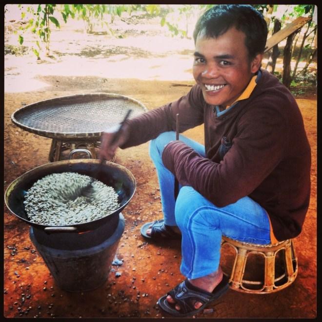 Mr. Vieng hand roasting coffee