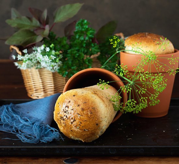 garlic bread with fresh herb in flower pots