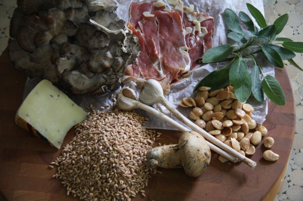 Stunning ingredients for Farro Salad sit on a wood platter