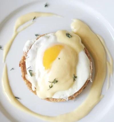 Fried egg with hollandaise sauce on toast.