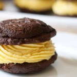 Whoopie pie with pumpkin cream cheese filling on plate